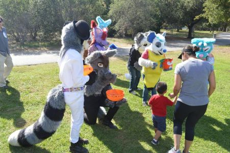 Fursuiters interacting with families from nearby photto by PonyQuest