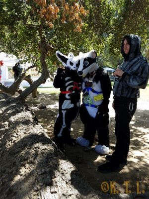 Fursuiters Necropsy and Surge standing by the trees
