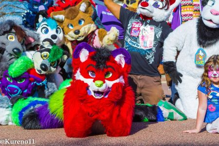 Majira Strawberry on their stomach during the SD Furries group shot