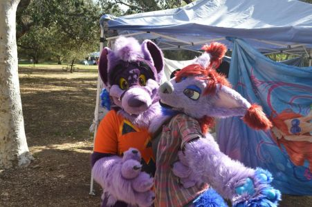 Two fursuiters posed for the camera in front of the changing tent photo by PonyQuest