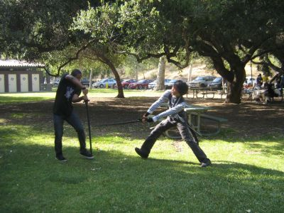 Two attendees fighting with wood and foam weapons