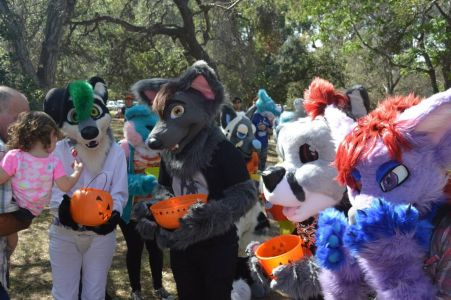 Fursuiters interacting as they trick or treat photo courtesy of PonyQuest