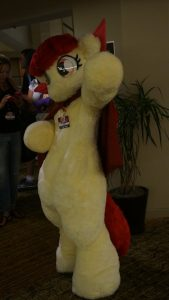 Apple Bloom costume fursuit waving at Equestria LA