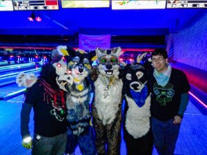 Fursuiter at Fursuit Group Shot at Zodos Bowling Alley during Saturday's Glow event