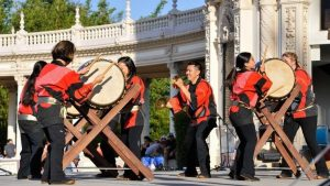 A group of taiko drummers performs on stage at the Bon Odori Festival.