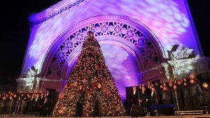 "The Del Cerro Baptist Church Choir performing the ""Living Christmas Tree"" on the Organ Pavilion stage. Image courtesy of the San Diego Union-Tribune."