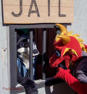 Chance Dragon gnawing at the bars while visiting a friend in a mock jail