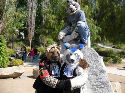 Group Shot of the three fursuiters with the boulder