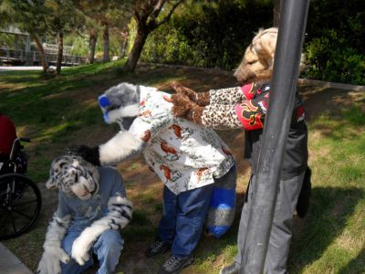 Fursuiters giving head scratches