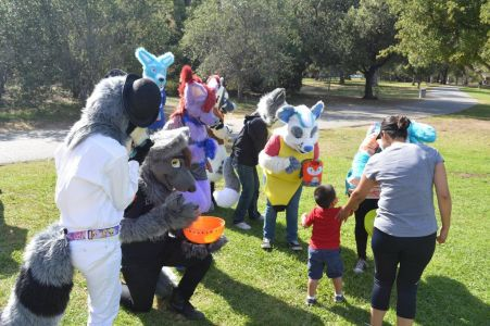Fursuiters stop for interaction photo by PonyQuest