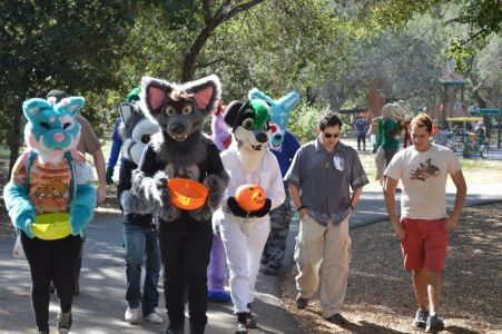 Group of fursuiters marching out for trick-or-treat ing photo by PonyQuest