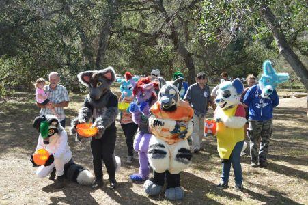 group shot with fursuiters holding pumpkin jack-o-lanterns photo courtesy PonyQuest